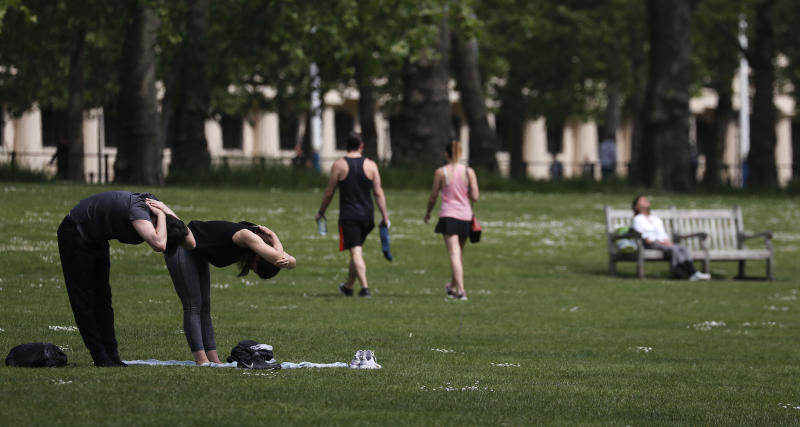 People exercise in St James Park in London, Sunday, May 10, 2020 during the nation-wide coronavirus lockdown. Personal exercise while observing social distancing measures is allowed under government lockdown guidelines.  (AP Photo/Frank Augstein)
