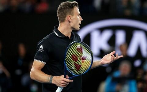 Marton Fucsovics of Hungary reacts during his Men's Singles fourth round match against Roger Federer of Switzerland on day seven of the 2020 Australian Open at Melbourne Park on January 26, 2020 in Melbourne, Australia