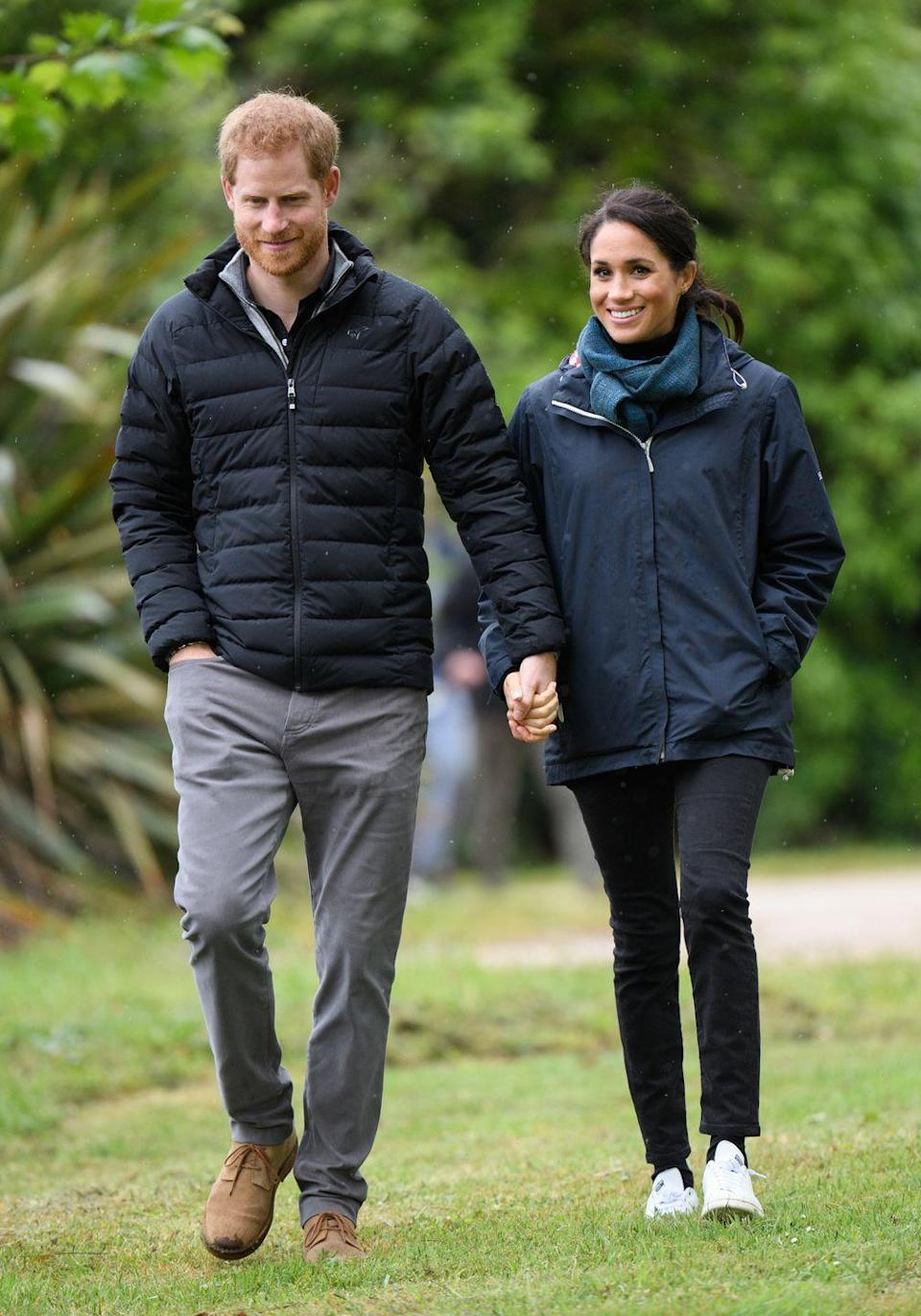 <p>Harry holds hands with Meghan as they walk around Abel Tasman National Park Wellington, New Zealand. </p>