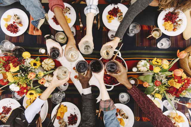 Cheers to making this the best Friendsgiving yet. (Photo: Getty Images)