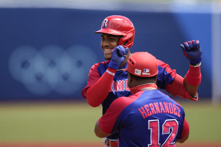 Dominican Republic's Julio Rodriguez celebrates after hitting a single against Japan during the first inning of a baseball game at the 2020 Summer Olympics, Wednesday, July 28, 2021, in Fukushima, Japan. (AP Photo/Jae C. Hong)