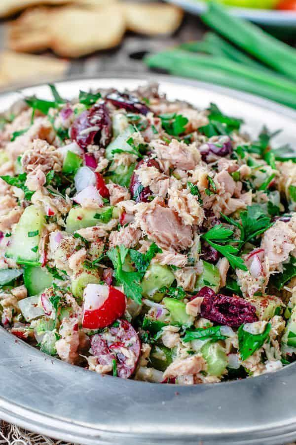 """<p>A zesty dressing takes this healthy tuna salad to the next level. Everyone at the dinner table will be piling plenty on their plates.</p><p><strong>Get the recipe at <a href=""""https://www.themediterraneandish.com/mediterranean-tuna-salad/"""" target=""""_blank"""">The Mediterranean Dish</a>.</strong></p>"""