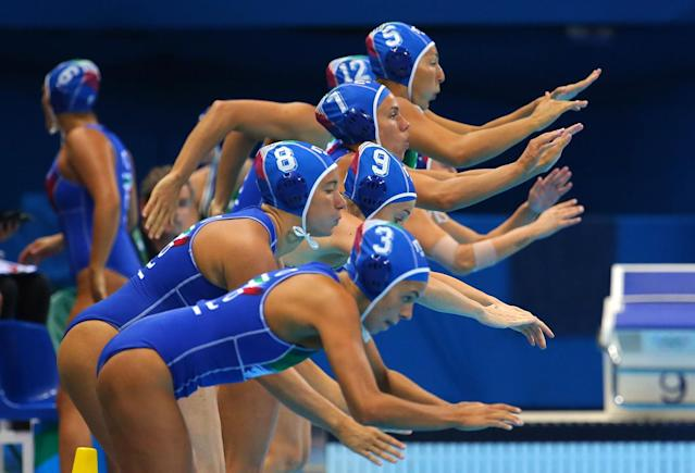 <p>Italian players jump into the water before the start of the game against Russia in the women's water polo semifinals on August 17, 2016. (REUTERS/Laszlo Balogh) </p>