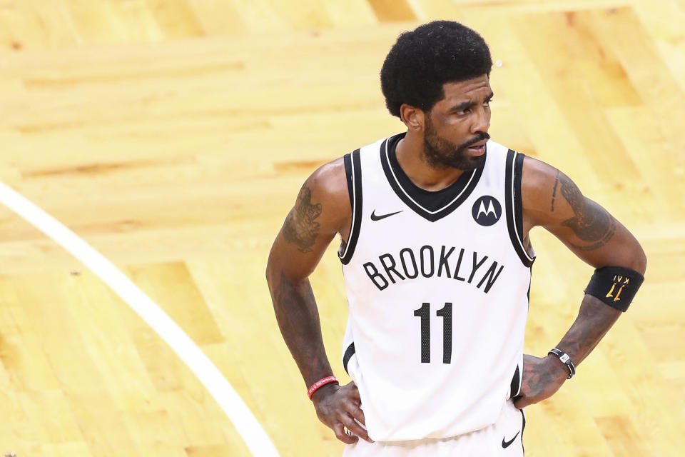 BOSTON, MA - MAY 28:  Kyrie Irving #11 of the Brooklyn Nets looks on during Game Three of the Eastern Conference first round series against the Boston Celtics at TD Garden on May 28, 2021 in Boston, Massachusetts. NOTE TO USER: User expressly acknowledges and agrees that, by downloading and or using this photograph, User is consenting to the terms and conditions of the Getty Images License Agreement. (Photo by Adam Glanzman/Getty Images)