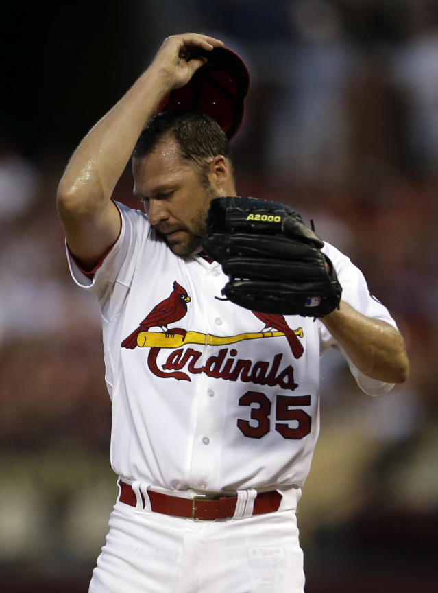 St. Louis Cardinals pitcher Jake Westbrook pauses on the mound after giving up a single to Los Angeles Dodgers' Yasiel Puig during the second inning of a baseball game Wednesday, Aug. 7, 2013, in St. Louis. Westbrook had to take over for Cardinals starting pitcher Shelby Miller after Miller was hit by a batted ball and had to leave the game after throwing only two pitches. (AP Photo/Jeff Roberson)