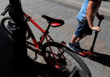 A boy rides at a kick scooter in central Moscow, Russia July 2, 2018. REUTERS/Gleb Garanich