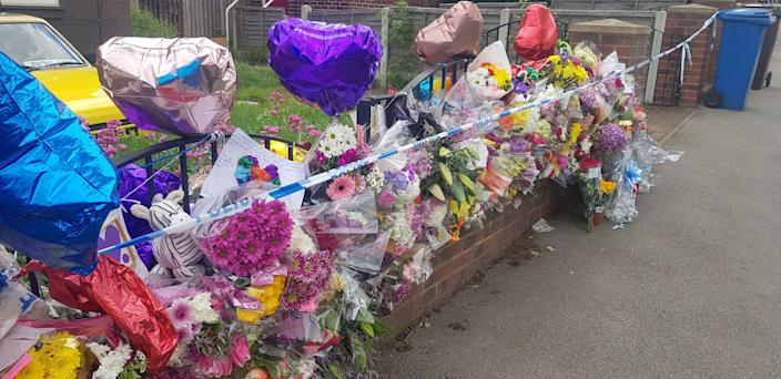 Floral tributes outside a property in the Shiregreen area of Sheffield where Blake Barrass, 14, and 13-year-old Tristan Barrass died following an incident on Friday (Picture: PA)