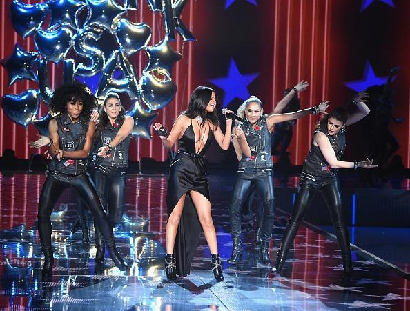 <p>Performing throughout the Victoria's Secret PINK portion of the show, Selena Gomez danced with leather jacket clad backup dancers, sang a medley of hits from her album <i>Revival</i>, and kissed her new model friends. She even had a special moment with Gigi Hadid, a fellow member of Taylor Swift's girl squad, in the middle of all the madness. </p>