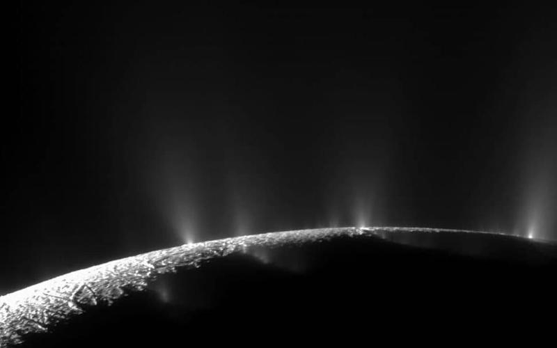 Plumes of vapour shooting up from Enceladus' ocean  - Credit: Nasa