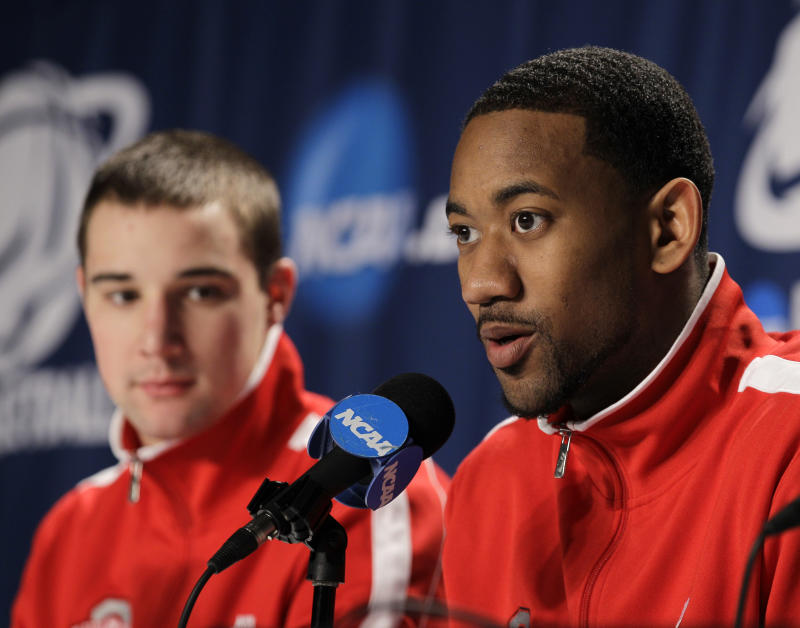 Ohio State's David Lighty, right, answers questions at a news conference with teammate Aaron Craft in the third round of the East regional NCAA college basketball tournament Saturday, March 19, 2011, in Cleveland. Ohio State plays George Mason Sunday. (AP Photo/Mark Duncan)