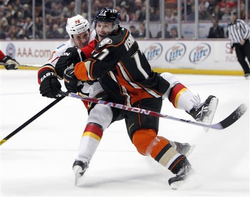 Calgary Flames left wing Curtis Glencross (20), left, collides with Anaheim Ducks defenseman Lubomir Visnovsky (17), of Czech Republic, in the first period of an NHL hockey game in Anaheim, Calif., on Friday, March 2, 2012. (AP Photo/Christine Cotter)