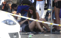 <p>Injured people are treated in Barcelona, Spain, Aug. 17, 2017 after a white van jumped the sidewalk in the historic Las Ramblas district, crashing into a summer crowd of residents and tourists and injuring several people, police said. (Oriol Duran/AP) </p>