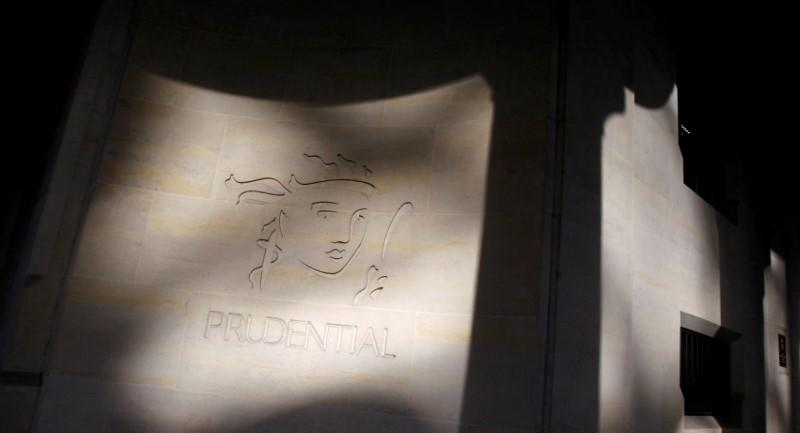 Shadows are cast onto the logo of British life insurer Prudential on their building in London
