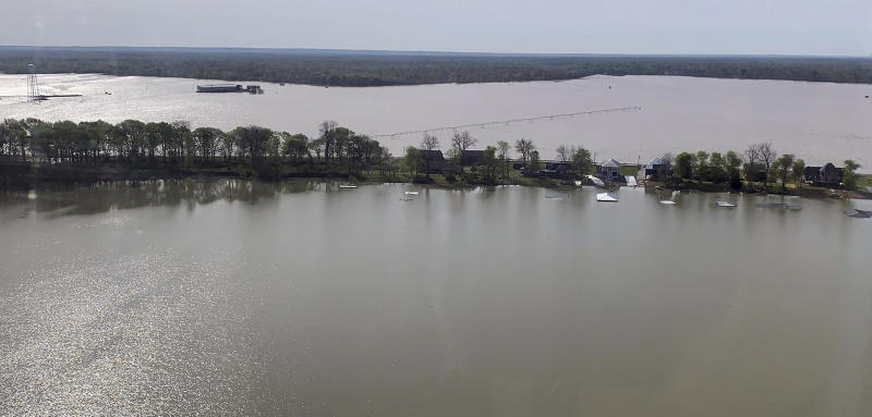 In this photo provided by the Mississippi Emergency Management Agency, homes in the Eagle Lake community of rural Warren County, Miss., are under siege from back flow waters as well as the lake, as seen in this image taken during a Wednesday, April 3, 2019 morning flyover by state and federal officials. (Ray Coleman/Mississippi Emergency Management Agency via AP)