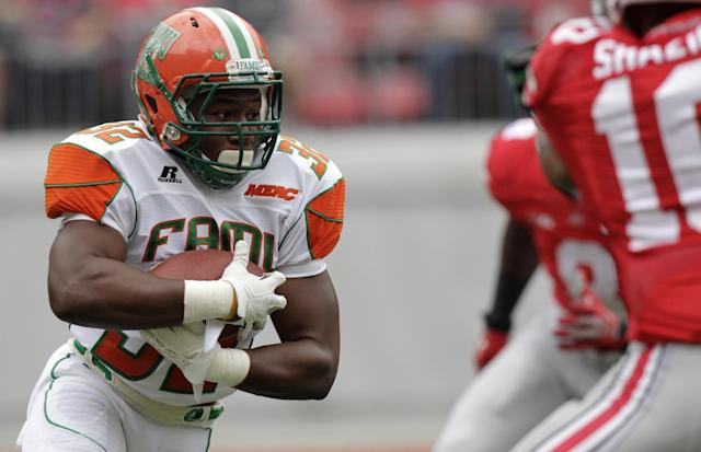 Florida A&M running back Omari Albert runs the ball against Ohio State during the first quarter of an NCAA college football game Saturday, Sept. 21, 2013, in Columbus, Ohio. (AP Photo/Jay LaPrete)