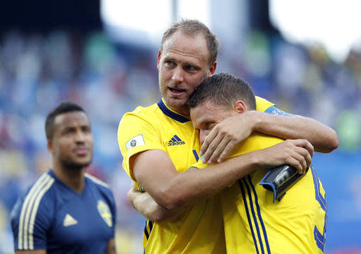 Sweden's Andreas Granqvist, left, and Marcus Berg embrace after the group F match between Sweden and South Korea at the 2018 soccer World Cup in the Nizhny Novgorod stadium in Nizhny Novgorod, Russia, Monday, June 18, 2018. Sweden won 1-0. (AP Photo/Pavel Golovkin)