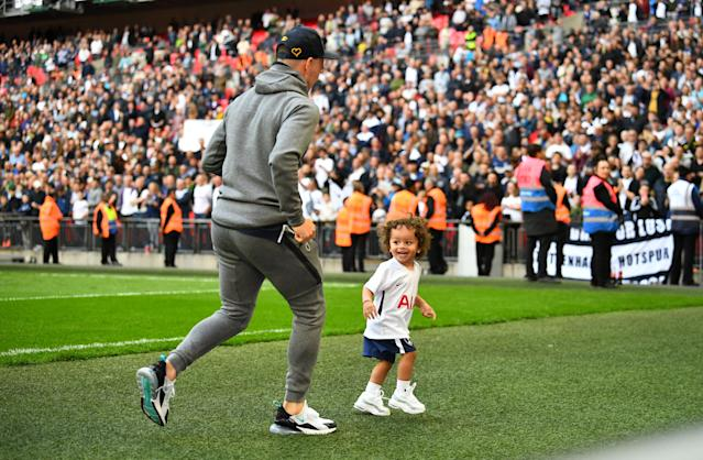 "Soccer Football - Premier League - Tottenham Hotspur vs Leicester City - Wembley Stadium, London, Britain - May 13, 2018 Tottenham's Kieran Trippier with his children after the match REUTERS/Dylan Martinez EDITORIAL USE ONLY. No use with unauthorized audio, video, data, fixture lists, club/league logos or ""live"" services. Online in-match use limited to 75 images, no video emulation. No use in betting, games or single club/league/player publications. Please contact your account representative for further details."