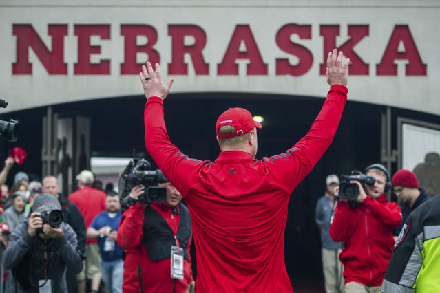 Nebraska head coach Scott Frost waves to the fans while walking off the field after the Red/White football game in Lincoln, Neb., Saturday, April 21, 2018. (AP Photo/John Peterson)