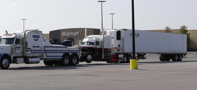 <p>A tractor-trailer is pulled from the scene where San Antonio police and other agencies investigate the scene where eight people were found dead in the trailer loaded with at least 30 others outside a Walmart store in stifling summer heat in what police are calling a horrific human trafficking case, Sunday, July 23, 2017, in San Antonio. (AP Photo/Eric Gay) </p>