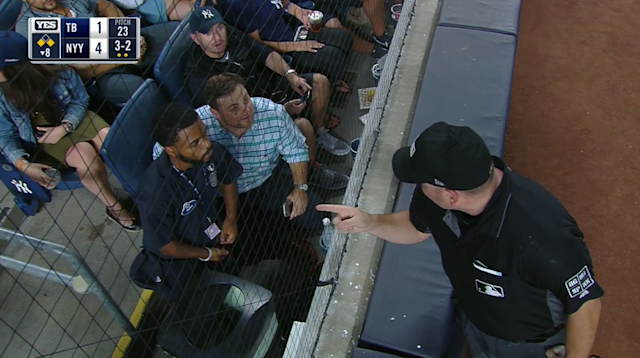Umpire Dan Bellino ejects a Yankees fan who was yelling pitch locations to Gary Sanchez. (MLB.TV)