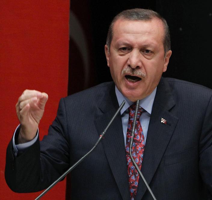 Turkish Prime Minister Recep Tayyip Erdogan defends the legislation passed earlier Friday, that bans advertising alcohol, during an address to his party members in Ankara, Turkey, Friday, May 24, 2013. Tempers flared and scuffles broke out during an all-night legislative session of parliament that passed a bill banning all forms of advertising alcohol. Legislation passed in Turkey's parliament early Friday that would ban all alcohol advertising and tighten restrictions on the sale of such beverages, and how such a law could affect tourists and liquor companies in the mainly Muslim but secular country.(AP Photo)