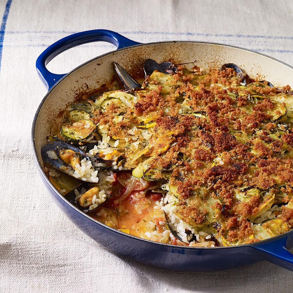 <p>In this Italian paella recipe, potatoes and other vegetables are layered with mussels and rice and baked in a casserole dish. Be sure to cover the rice completely with vegetables to ensure it cooks properly.</p>