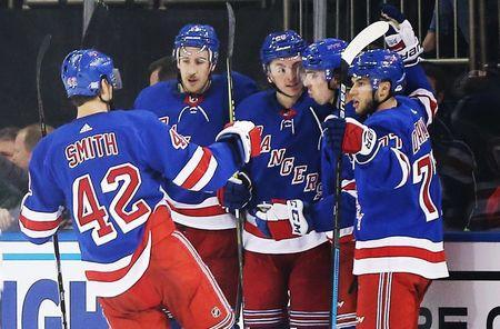 Nov 19, 2018; New York, NY, USA; New York Rangers center Filip Chytil (72) is congratulated after scoring the winning goal against the Dallas Stars during the third period at Madison Square Garden. Mandatory Credit: Andy Marlin-USA TODAY Sports