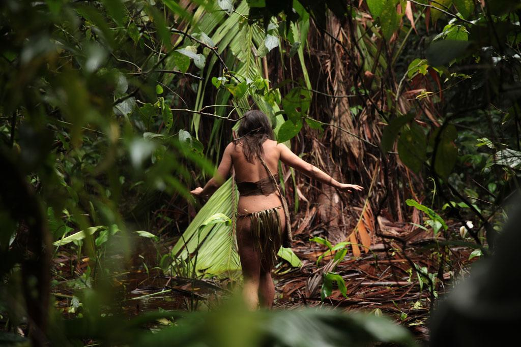 """Laura walking through the inland of Panama to find material and food for herself and Clint on Discovery Channel's """"Naked & Afraid."""""""