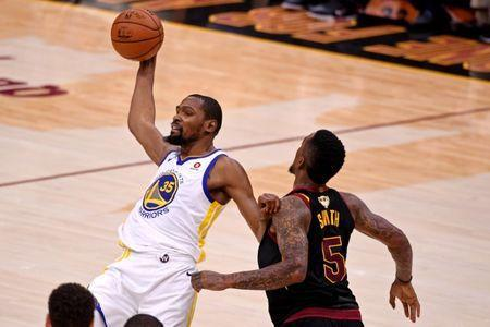 Jun 8, 2018; Cleveland, OH, USA; Golden State Warriors forward Kevin Durant (35) handles the ball against Cleveland Cavaliers guard JR Smith (5) during the third quarter in game four of the 2018 NBA Finals at Quicken Loans Arena. Mandatory Credit: Kyle Terada-USA TODAY Sports