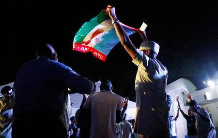 Supporters of Nigeria's President Muhammadu Buhari celebrate at the campaign headquarters of the All Progressives Congress (APC) party in Abuja, Nigeria February 26, 2019. REUTERS/Nneka Chile
