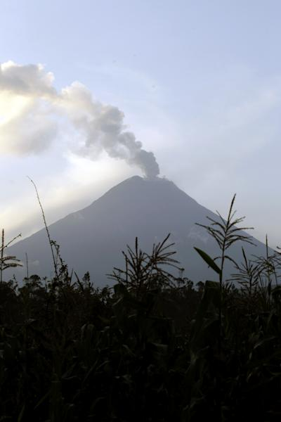 An ash-filled plume rises from the Tungurahua volcano as seen from Huambalo, Ecuador, Monday, Dec. 17, 2012. The country's National Geophysics Institute says that a constant plume of gas and ash is rising about half a mile (1 kilometer) above the crater, with ash falling on nearby communities. (AP Photo/Dolores Ochoa)