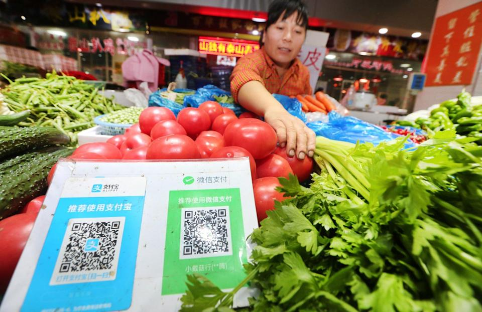 QR codes of digital payment apps WeChat Pay and its competitor Alipay at a free market in Nantong city, east China's Jiangsu province. Photo: AFP