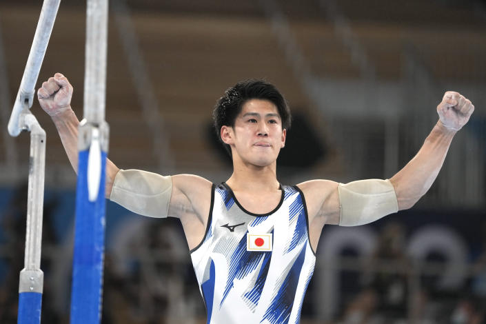 Daiki Hashimoto, of Japan, finishes on the parallel bars during the artistic gymnastics men's all-around final at the 2020 Summer Olympics, Wednesday, July 28, 2021, in Tokyo. (AP Photo/Natacha Pisarenko)