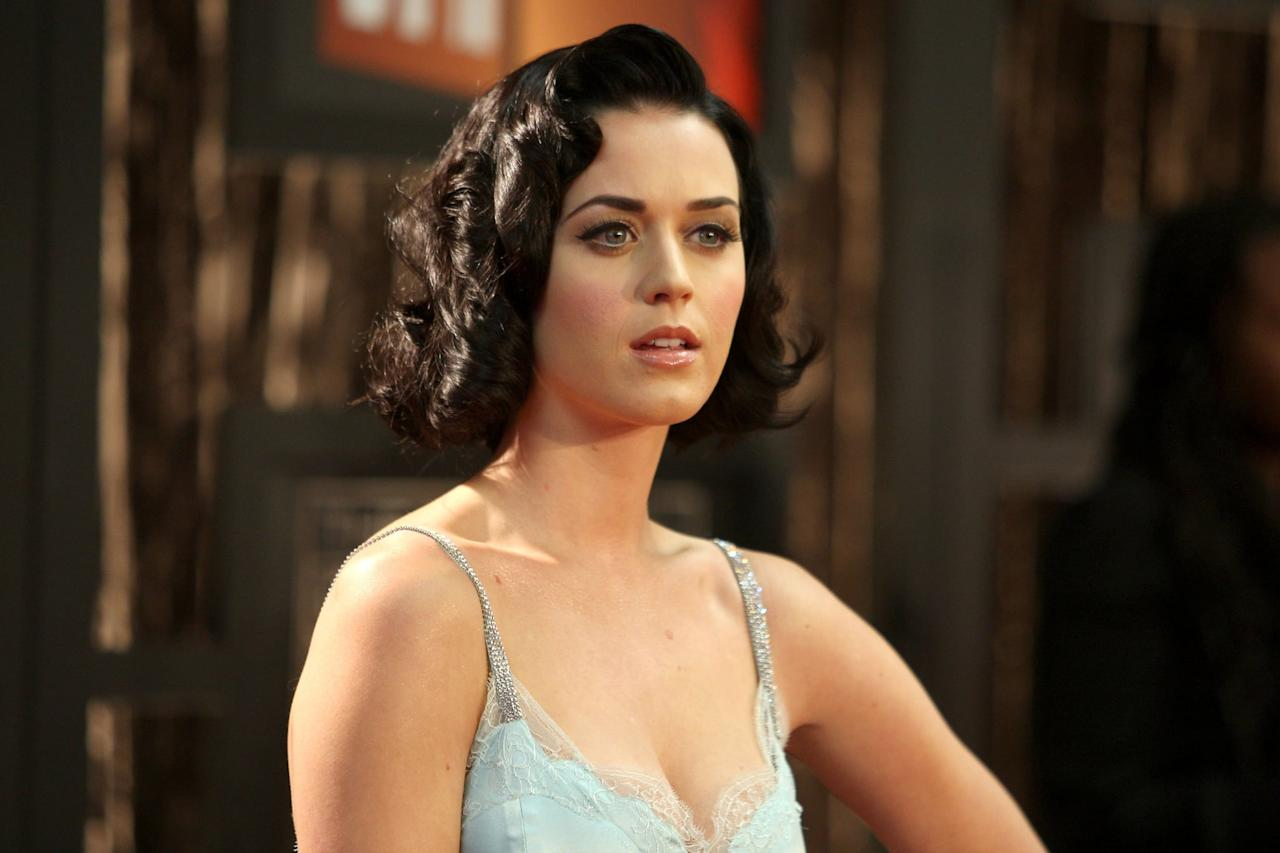 <p>For the 2009 Critics' Choice Awards, Perry left the bright colors behind for a subtler look. With a neutral makeup palette and retro-style wavy hair, she stood out for a totally new reason.</p>