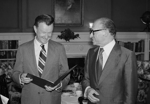 <p>National Security Advisor Zbigniew Brzezinski, left, chats with Israeli Prime Minister Menachem Begin during a breakfast meeting at Blair House in Washington Wednesday, July 20, 1977. Begin is in the Capital for talks with President Jimmy Carter.(Photo: Barry Thumma/AP) </p>