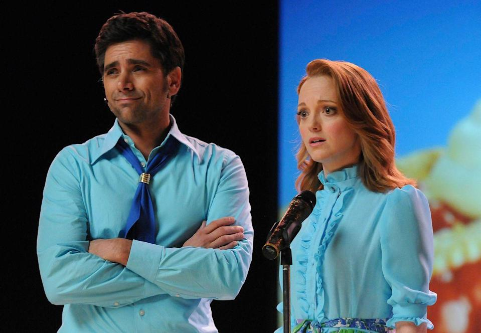 "<p>If you only get one complaint about the Mr. Shue-Emma relationship, it might as well be that it meant you only got to see John Stamos as sexy dancing dentist Carl Howell for one season of <em>Glee</em>. </p><p>The two end up getting married in Vegas, but when it's revealed that Emma is still confused about her feelings for Will, Carl moves into a hotel. ""It's really nice that this show worked,"" John told <em><a href=""https://ew.com/article/2010/10/21/glee-exclusive-john-stamos-frank-n-furter/"" rel=""nofollow noopener"" target=""_blank"" data-ylk=""slk:Entertainment Weekly"" class=""link rapid-noclick-resp"">Entertainment Weekly</a>.</em> ""They goofed on me in the beginning, so I had to secretly watch it, because I loved it so much. I told everybody I hated it, but I was a closet <em>Glee </em>fan.""<br></p>"