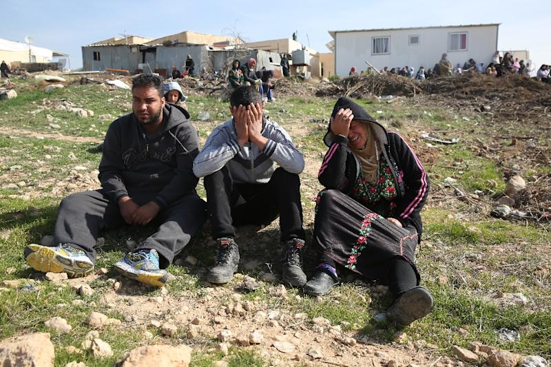 Bedouins cry following the destruction of houses on January 18, 2017 in the Bedouin village of Umm al-Hiran, which is not recognized by the Israeli government, near the southern city of Beersheba, in the Negev desert (AFP Photo/MENAHEM KAHANA)