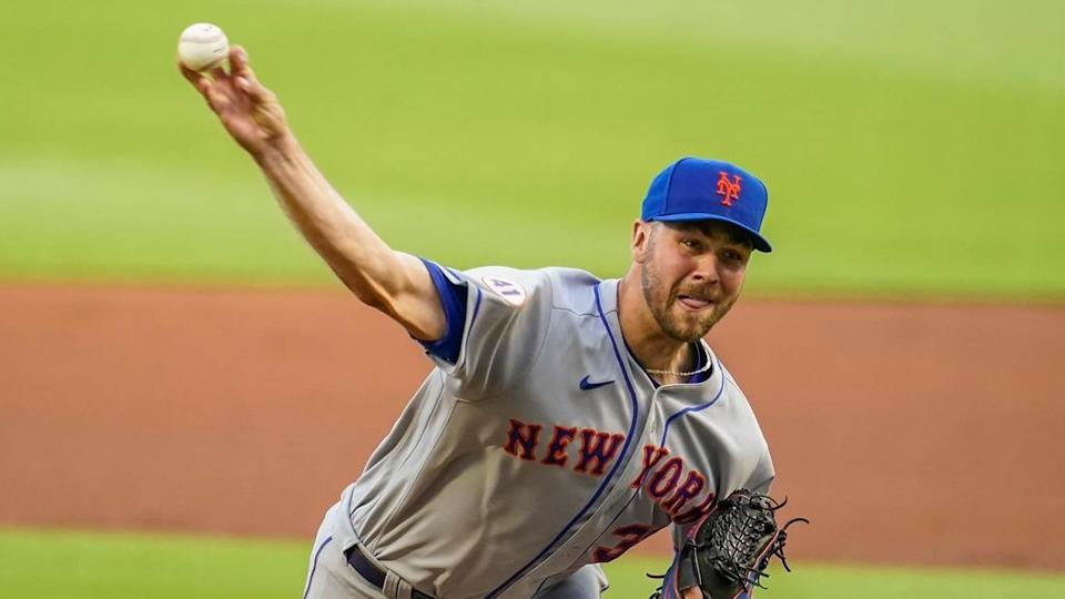 New York Mets relief pitcher Tylor Megill (38) pitches against the Atlanta Braves during the first inning at Truist Park.