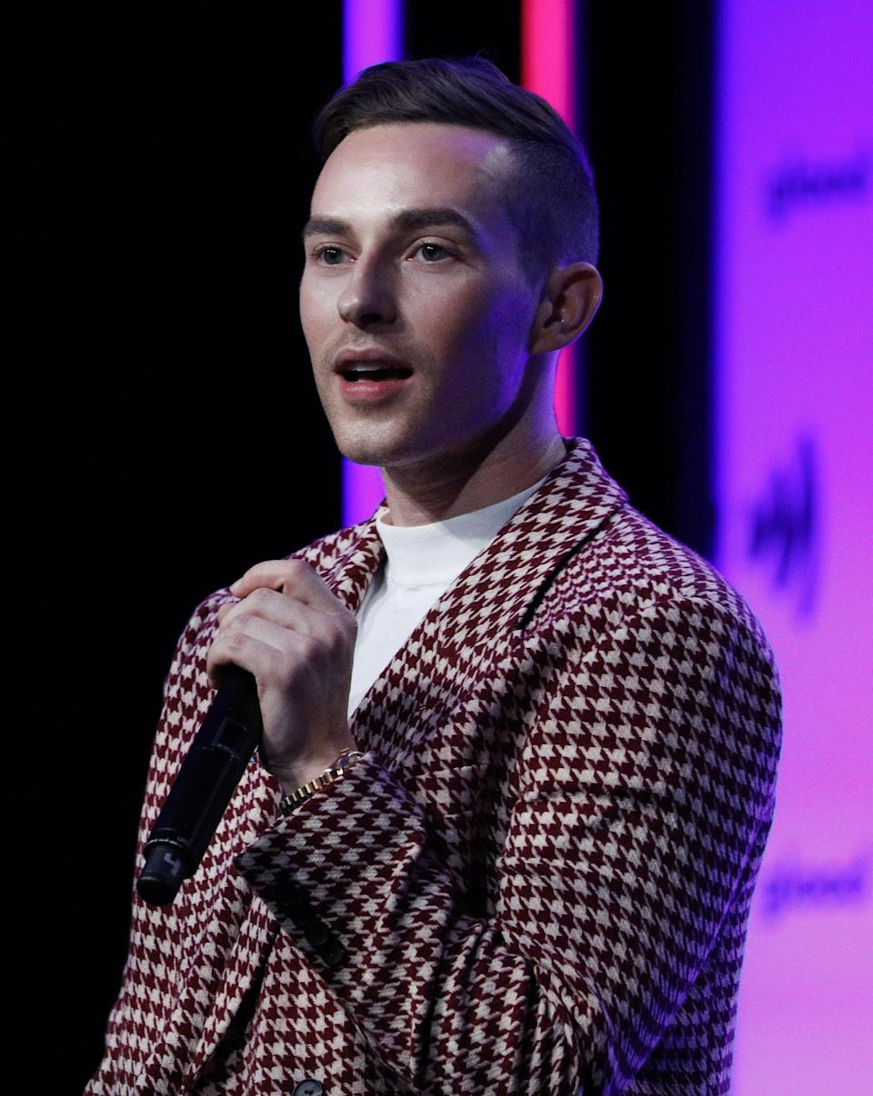 """<p>Adam Rippon skated to an Olympic bronze medal in 2018, won the 2016 National Championships, and, after publicly coming out in a 2015 interview, became the first openly gay American to qualify for the Olympics. He's been open about the <a href=""""https://www.today.com/parents/spirit-day-2019-adam-rippon-how-he-deals-bullies-t164787"""" class=""""link rapid-noclick-resp"""" rel=""""nofollow noopener"""" target=""""_blank"""" data-ylk=""""slk:bullying he experienced"""">bullying he experienced</a> growing up, telling <strong>Today</strong>, """"One time, I was in the fourth grade and somebody said, 'Oh, because you skate, you're gay.' And I didn't even know what that meant. But to me it felt like they were trying to insult me and I felt so exposed in front of all of my classmates and my peers. I felt embarrassed and I didn't know why and I didn't even know what being gay really meant.""""</p> <p>He said his friends, family, and passion for skating helped him rise above the bullies, and after coming out, he said his <a href=""""https://www.washingtonpost.com/sports/olympics/figure-skater-adam-rippon-on-coming-out-i-felt-myself-owning-who-i-was/2018/02/05/09cc7b60-0820-11e8-b48c-b07fea957bd5_story.html"""" class=""""link rapid-noclick-resp"""" rel=""""nofollow noopener"""" target=""""_blank"""" data-ylk=""""slk:performance on the ice improved remarkably"""">performance on the ice improved remarkably</a>. In a 2018 interview with <strong>InStyle</strong>, Rippon said, """"It's a really liberating experience to <a href=""""https://www.instyle.com/news/adam-rippon-olympic-figure-skater-coming-out"""" class=""""link rapid-noclick-resp"""" rel=""""nofollow noopener"""" target=""""_blank"""" data-ylk=""""slk:just be yourself"""">just be yourself</a>.""""</p>"""