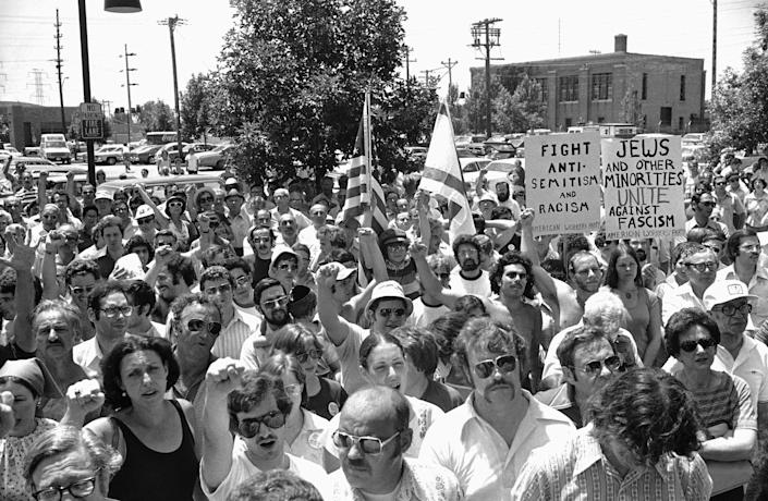 A large group of anti-Nazi demonstrators chant at a park in the predominantly Jewish Chicago suburb of Skokie, Ill., on July 4, 1977, protesting a possible march in Skokie by Nazis. (Photo: Charles Knoblock/AP)