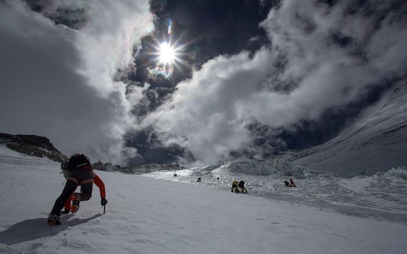 Ueli Steck (left) on the Lhotse Face of Mt Everest - Credit: Alpine Exposures