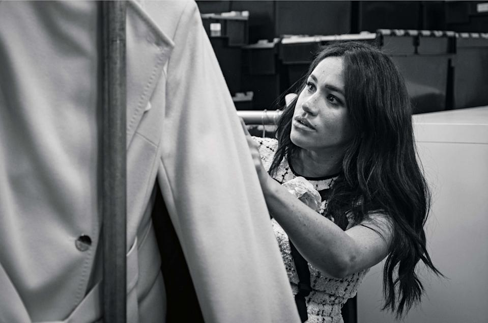 """This undated handout photo issued on July 28, 2019 by Kensington Palace shows Britain's Meghan, Duchess of Sussex, Patron of Smart Works, in the workroom of the Smart Works London office. - Prince Harry's wife Meghan will guest edit the September issue of iconic fashion magazine British Vogue, which will see her in """"candid conversation"""" with former first lady Michelle Obama. (Photo by @SussexRoyal / KENSINGTON PALACE / AFP) / XGTY / RESTRICTED TO EDITORIAL USE - MANDATORY CREDIT """"AFP PHOTO / @SUSSEXROYAL"""" - NO MARKETING NO ADVERTISING CAMPAIGNS - NO COMMERCIAL USE - NO THIRD PARTY SALES - RESTRICTED TO SUBSCRIPTION USE - NO CROPPING OR MODIFICATION - DISTRIBUTED AS A SERVICE TO CLIENTS /         (Photo credit should read @SUSSEXROYAL/AFP/Getty Images)"""