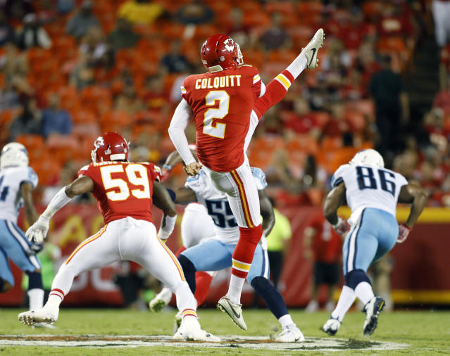 FILE - In this Aug. 31, 2017, file photo, Kansas City Chiefs' Dustin Colquitt (2) punts during the first half of an NFL preseason football game against the Tennessee Titans, in Kansas City, Mo. The Chiefs have agreed to a three-year, $7.5 million contract with longtime punter Dustin Colquitt on Thursday, March 15, 2018, a deal that could ensure he plays the rest of his career in Kansas City. (AP Photo/Colin E. Braley, File)
