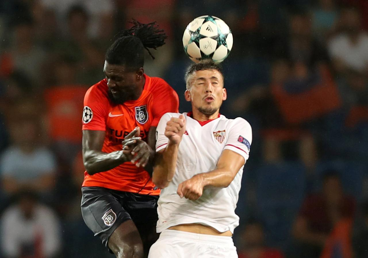 Soccer Football - Champions League - Istanbul Basaksehir vs Sevilla - Qualifying Play-Off First Leg - Istanbul, Turkey - August 16, 2017   Sevilla's Clement Lenglet in action with Istanbul Basaksehir's Emmanuel Adebayor    REUTERS/Osman Orsal     TPX IMAGES OF THE DAY
