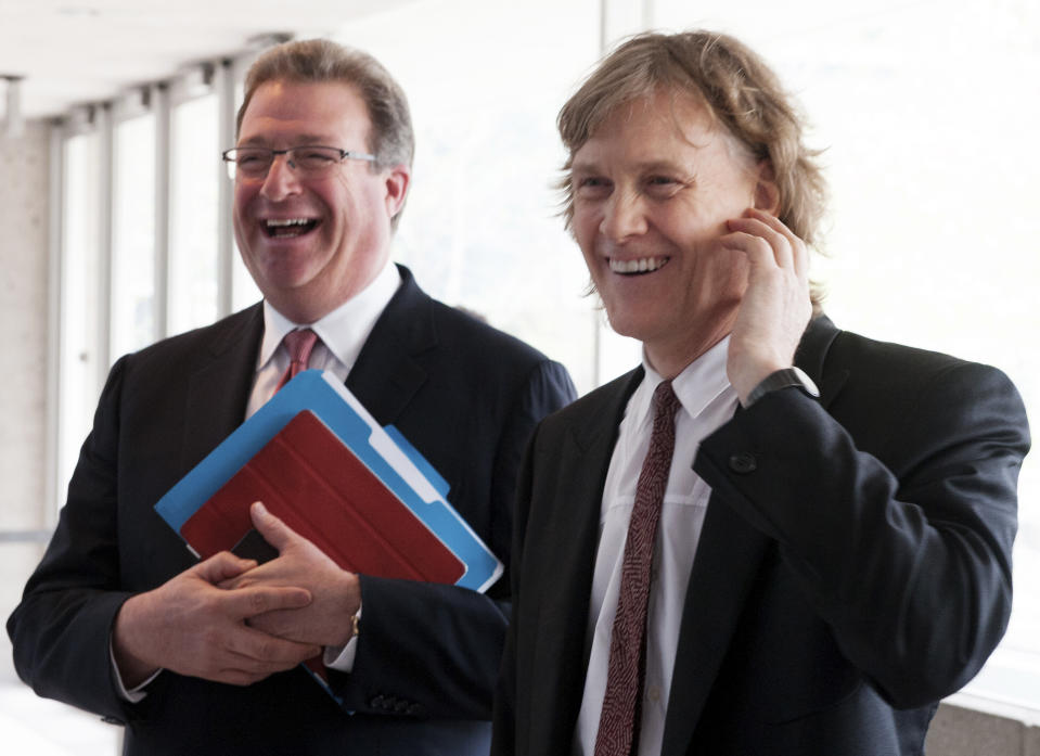 Thomson Reuters President and Chief Executive Officer James Smith (L) and Chariman David Thomson laugh before entering their annual general meeting for shareholders in Toronto, May 8, 2013.  REUTERS/Jon Blacker (CANADA - Tags: BUSINESS)