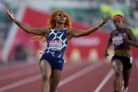 Sha'Carri Richardson celebrates after winning the fourth heat during the women's 100-meter run at the U.S. Olympic Track and Field Trials Friday, June 18, 2021, in Eugene, Ore. (AP Photo/Ashley Landis)