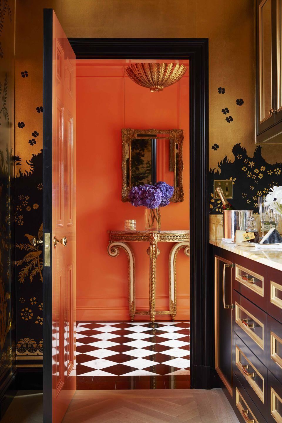 """<p>For the bar in her Manhattan apartment, design historian and author <a href=""""https://maureenfooter.com/"""" rel=""""nofollow noopener"""" target=""""_blank"""" data-ylk=""""slk:Maureen Footer"""" class=""""link rapid-noclick-resp"""">Maureen Footer</a> chose a custom wallpaper inspired by the work of Armand-Albert Rateau, a French furniture and interior designer who helped popularize the Art Deco movement. The Louis XVI console is from <a href=""""http://www.delvaille.art/"""" rel=""""nofollow noopener"""" target=""""_blank"""" data-ylk=""""slk:Galerie Delvaille"""" class=""""link rapid-noclick-resp"""">Galerie Delvaille</a>; the pendant light is by <a href=""""https://www.circalighting.com/our-designers/aerin/"""" rel=""""nofollow noopener"""" target=""""_blank"""" data-ylk=""""slk:Aerin for Visual Comfort"""" class=""""link rapid-noclick-resp"""">Aerin for Visual Comfort</a>. </p>"""