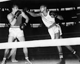 <p>Boxing champion, Muhammad Ali, took home a gold medal for his winning match in the light heavyweight division against three-time European champion, Zbigniew Pietrzykowski. </p>