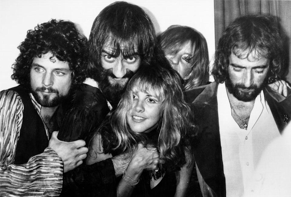 <p> Fleetwood Mac (L-R Lindsey Buckingham, Mick Fleetwood, Stevie Nicks Christine McVie, and John McVie) backstage at the Los Angeles Rock Awards on September 1, 1977 in Los Angeles, California.</p>
