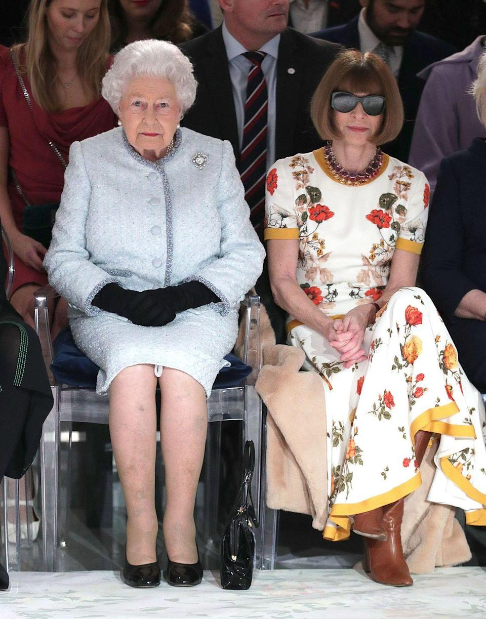 <p>Name a more iconic duo. We'll wait. The outfit Anna Wintour wore to sit next to HRH at London Fashion Week shows Wintour's own status as Queen of Fashion: caramel leather boots, dark sunglasses, it's all perfection.</p>